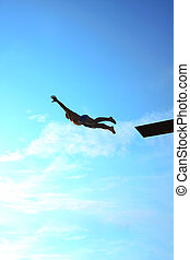 dive - man makes a jump into the water from a springboard
