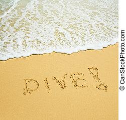 dive written in a sandy tropical beach