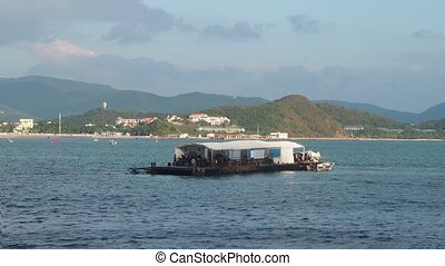 Diver boats in bay - Old fashioned diver boat with divers in...