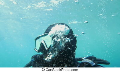 Diver Breathing Under the Water