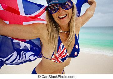 diversão amando, mulher, waving, orgulhosamente, a, bandeira australiana