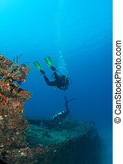 Divers on a shipwreck in south east Florida.