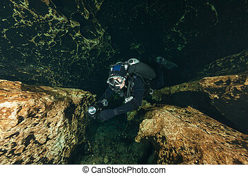 divers underwater caves diving Ginnie Springs Florida USA