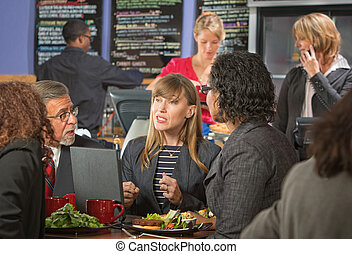 Diverse Business People Eating - Diverse group of business...