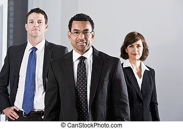 Diverse businesspeople in suits
