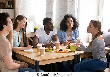 Diverse cheerful students preparing together for exam. - ...
