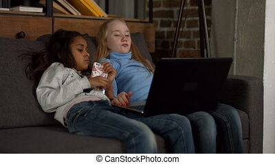 Diverse children watching tv show on laptop - Diverse...