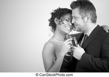 Diverse couple celebrating