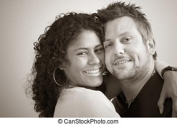 Diverse couple; closeness - Lovely couple close portrait in...
