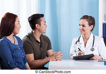 Diverse couple during medical appointment - View of diverse...