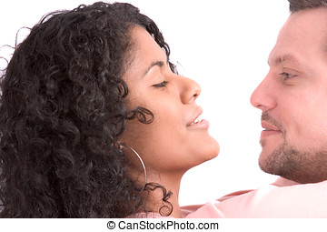 Diverse couple; heads close together