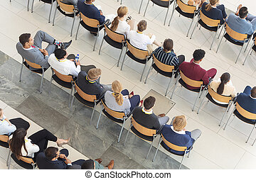 Diverse executives sat in conference room