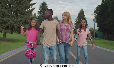 Diverse family with girls enjoying leisure outdoor - Happy ...