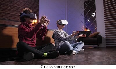 Diverse friends exploring virtual reality at home - Excited ...