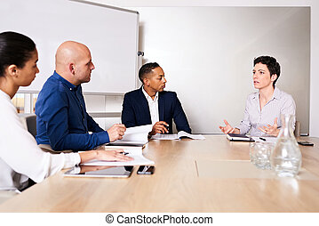 Diverse group of businesspersons conducting an important business meeting