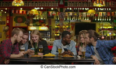 Diverse Group of Friends Celebrate with a Toast and Clink...