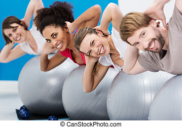 Diverse group of friends having fun at the gym