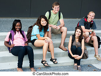 Diverse group of friends smiling on stairs together