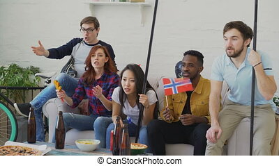 Diverse group of friends sport fans with Norwegian national...
