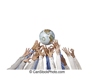 hands reaching a globe - Diverse group of hands reaching a...