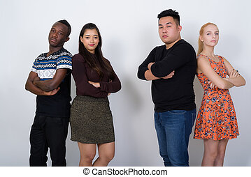 Diverse group of multi ethnic friends with arms crossed together