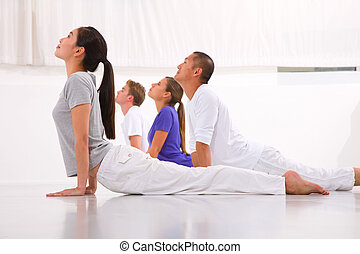 Diverse group of people practicing yoga