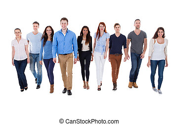 Diverse group of people walking towards camera