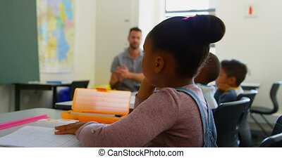 Diverse group of students applauding in classroom at school 4k