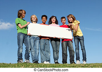 diverse group of summer camp kids with sign