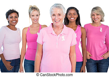 Diverse group of women wearing pink tops and breast cancer...