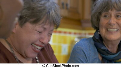 Diverse group of young senior women over 60 laughing and having fun