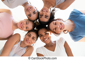 Diverse group of young sporty attractive girls enjoy time togeth