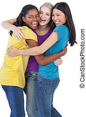 Diverse laughing women embracing each other on white...