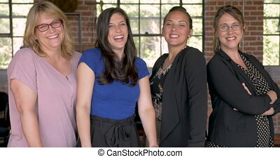 Diverse multi-ethnic all female entrepreneur team smiling for the camera