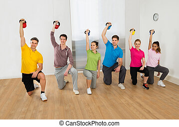 People Working Out With Kettle Bell Weights