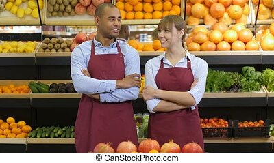 Diverse owners with arms crossed at grocery store - Portrait...