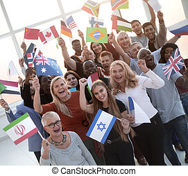 participants of the international forum with their national flags standing together