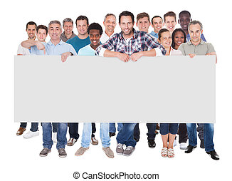 Full length portrait of diverse people in casuals holding blank placard over white background