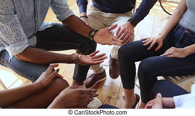Diverse people talking sit in circle at group counseling therapy session concept, multiracial patients communicating sharing problems get support at rehab addiction treatment meeting, close up view
