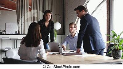 Diverse professional work team brainstorming in modern office