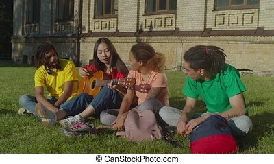 Diverse students enjoying leisure after studying