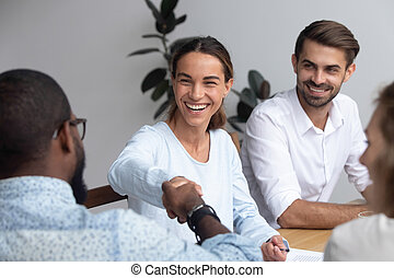 Diverse successful business people shaking hands during business