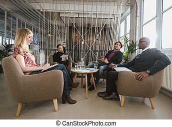 Diverse team of business people meeting in office lobby