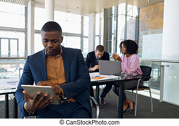 Diverse young business people working in modern office