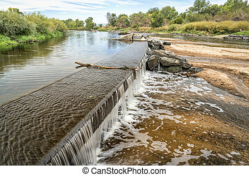 water diversion dam on the South Platte River in northern Colorado below Denver, early fall scenery with low water