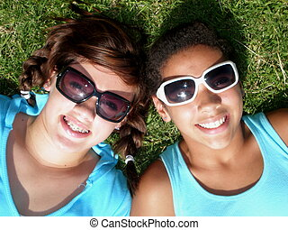 Diversity 2 - A picture of two girls, one black and one...