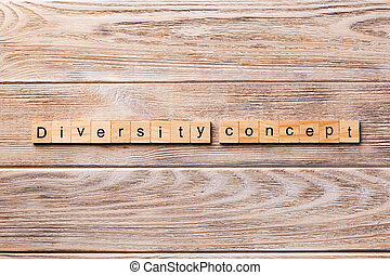 Diversity concept word written on wood block. Diversity concept text on wooden table for your desing