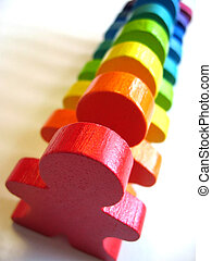 Diversity - Line of colorful wooden people. Metaphor for...