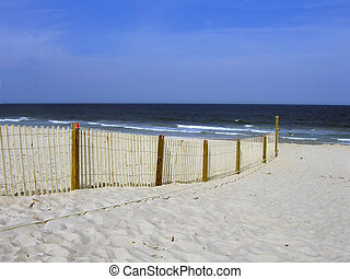 Divided Beach - Fence separates private from public beach