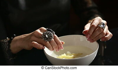 Divination with candle. woman pouring wax into the water.